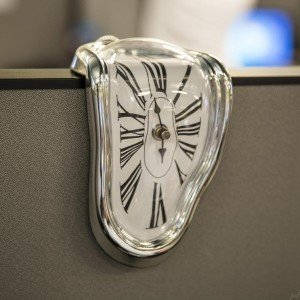melting clock on cubicle wall close up