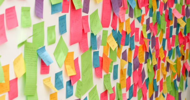 many-post-it-notes-cubicle-wall