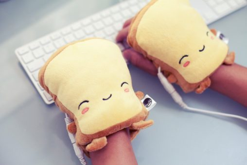 USB toast hand warmers being used in frigid cubicle