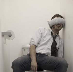 office-worker-sleeping-in-bathroom