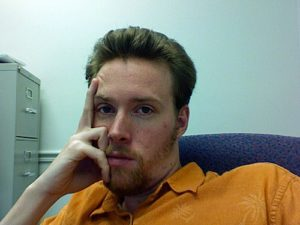 man bored in cubicle