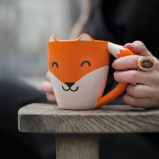 cute fox mug in use